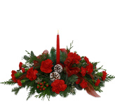 Beautiful Christmas flower centerpieces by Canada Flowers. Hurricane globe centerpieces and candle centerpieces. Festive party centerpieces for Christmas gifts.