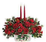 Beautiful Teleflora Christmas flower centerpieces by Canada Flowers. Hurricane globe centerpieces and candle centerpieces. Festive party centerpieces for Christmas gifts available for delivery in Canada.
